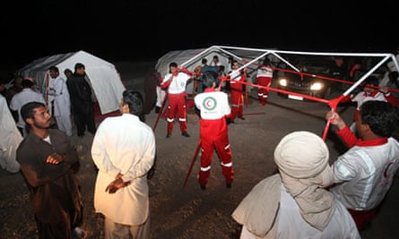 Iranian Red Crescent workers erect tents
