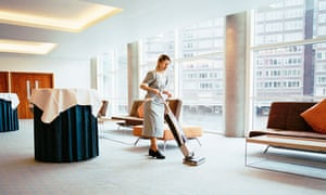 Woman Vacuuming in Conference Room