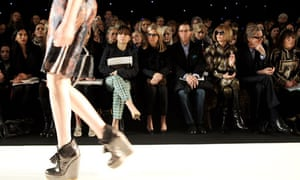 British Vogue editor Alexandra Shulman watches a model during the Mulberry autumn/winter 2012 show