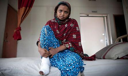 Nazma Akhtar sat on a bed