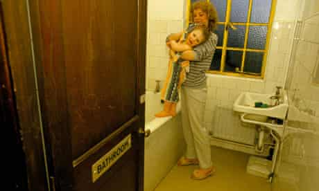 A homeless mother in a hostel bathroom