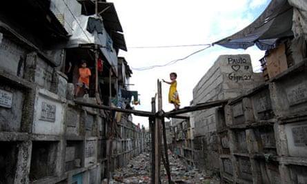A child walks in Manila cemetery