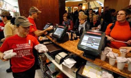 McDonald's staff members serve hamburgers at their fast food restaurant downtown Milan