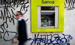 Bankia bank branch with graffiti on it in Madrid