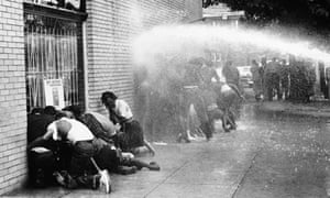 Civil rights protestors are attacked with a water cannon.