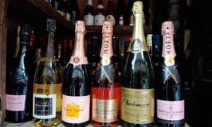 Champagne bottles displayed at a roadsid