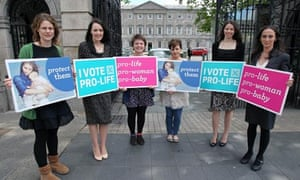 Six anti-abortion campaigners hold placards outside Leinster House, Dublin.