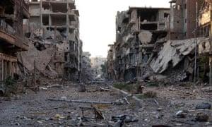 Damage and debris in Deir al-Zor