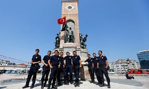 Turkish police pose for a picture at Taksim Square in Istanbul