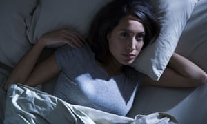 Woman in bed in semi-darkness