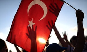 A protester holds up a Turkish flag