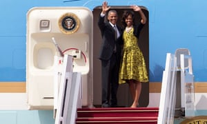 Barack and Michelle Obama wave as they board Air Force One to depart for South Africa