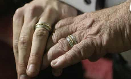 Men hold hands during gay marriage ceremony