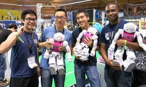 Students from the University of Pennsylvania's UPennalizer team show off their robot