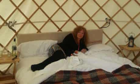 Suzanne Moore lying on a bed a yurt at Glastonbury