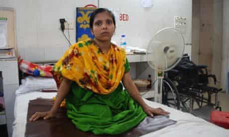 Pakhi Begum, 25, on her hospital bed in Savar