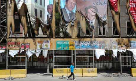 Political posters on the hording of partly demolished buildings in Tarlabasi