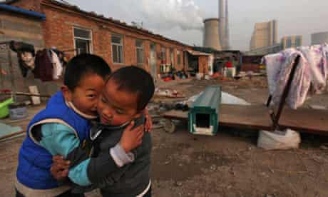 Chinese boys play near their home in Beijing.