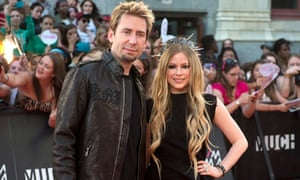 Chad Kroeger and Avril Lavigne pose on the red carpet at the 2013 MuchMusic video awards in Toronto