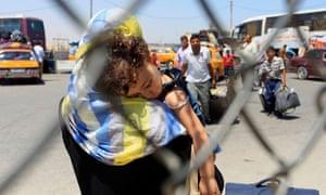 Palestinian travelers gather at the Rafa