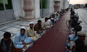 Afghan men wait for their free evening m
