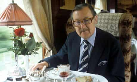 Alan Whicker seated at dinner in a railway carriage