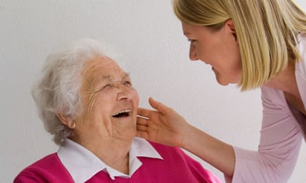 Young carer greets elderly woman