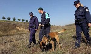 Greek police patrol the border with Turkey