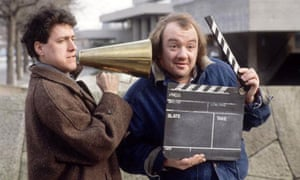 Mel Smith and Griff Rhys-Jones with megaphone and clapperboard on South Bank, London