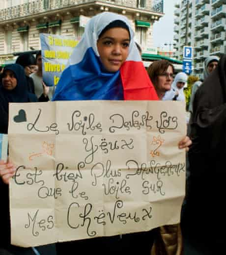 A Muslim woman protesting in Paris