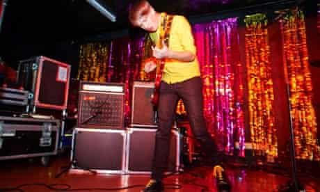 Eoin Loveless of Drenge on stage with guitar