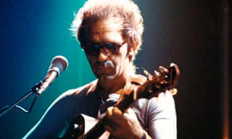 JJ Cale onstage with guitar
