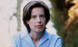 Author Susan Faludi Sitting on a pile of books
