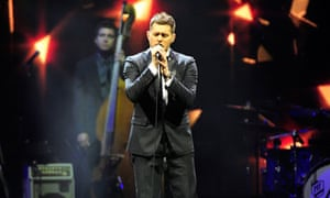 Michael Bublé on stage at the O2 Arena, London, bassist in background