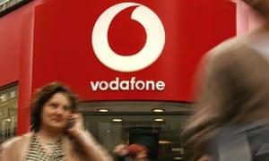 Customers outside Vodafone shop