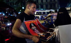 A man sells posters in Alexandria