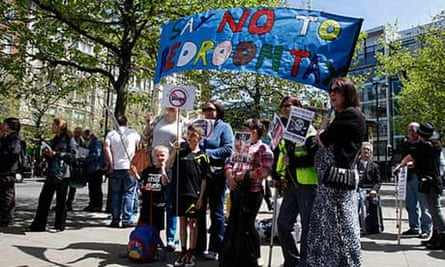 Anti-bedroom tax protesters in Manchester in June 2013