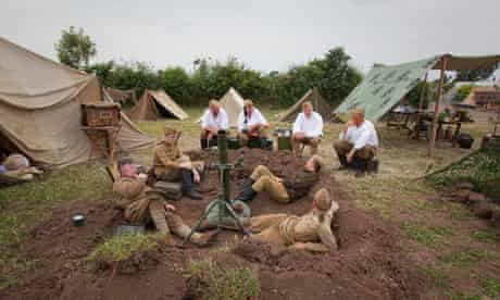 Re-enactors in Russian second world war uniforms, surrounded by tents