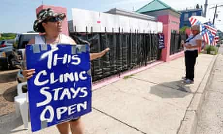 An abortion rights supporter with placard outside Mississippi's last abortion clinic.