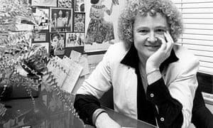 Sheila Whitaker sat at a desk, smiling