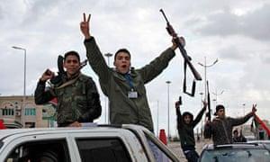Libyan gunmen on the anniversary of the revolution