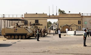Soldiers outside Tora prison, from where Hosni Mubarak will be freed imminently.