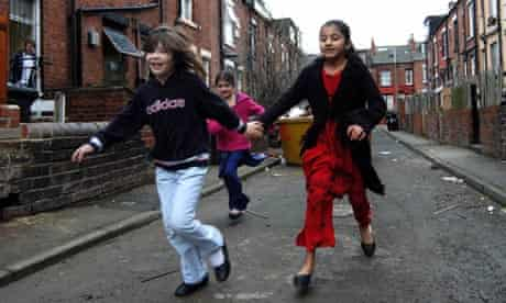 Children play together in Leeds. The city has one of the highest levels of child poverty in the UK.