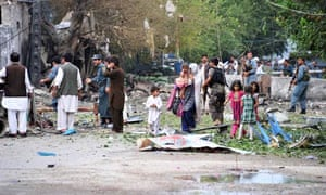 Police and civilians at the site of the suicide attack at the Indian consulate, in Jalalabad.