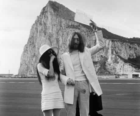John Lennon and Yoko Ono with their marriage certificate after their wedding in Gibraltar in 1969.