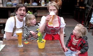 The Rowlatt family: Justin and Bee Rowlatt in 'traditional' German clothes drinking beer