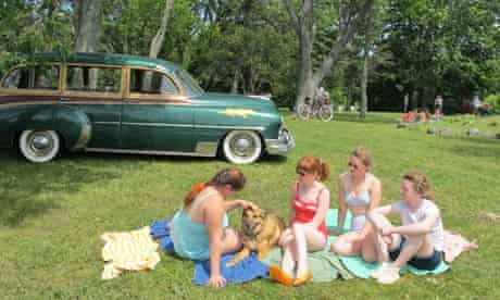 Scene from Foxfire: four girls have picnic with 1950s car in background