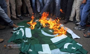 Supporters of India's main opposition Bharatiya Janata party (BJP) burn Pakistan flags