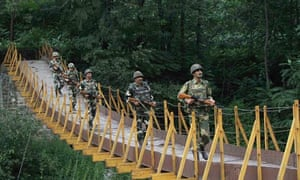 Indian soldiers cross a footbridge near the Line of Control in Kashmir.