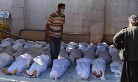 Bodies laid out after the attack on the rebel-held Ghouta suburb